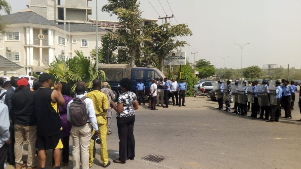 Photo of Tension as Police Anti-Riot Squad cordons Peace Corps office, confront officers