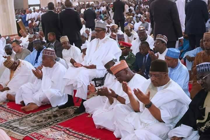 Photo of Controversy As Buhari Sitting On A Chair During Prayer In Mosque