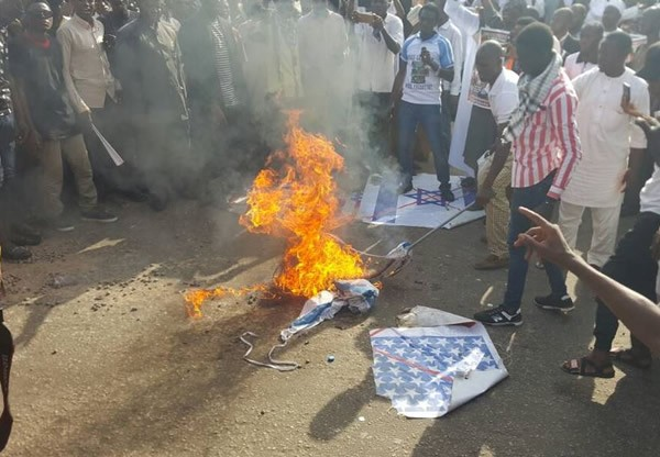 Photo of Tension In Abuja As Shiites Burn Flags Of US, Israel