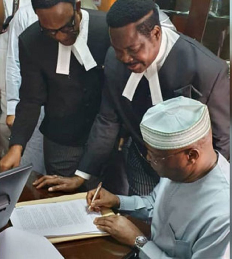 Photo of Atiku files N2.5b libel suit against Buhari's aide